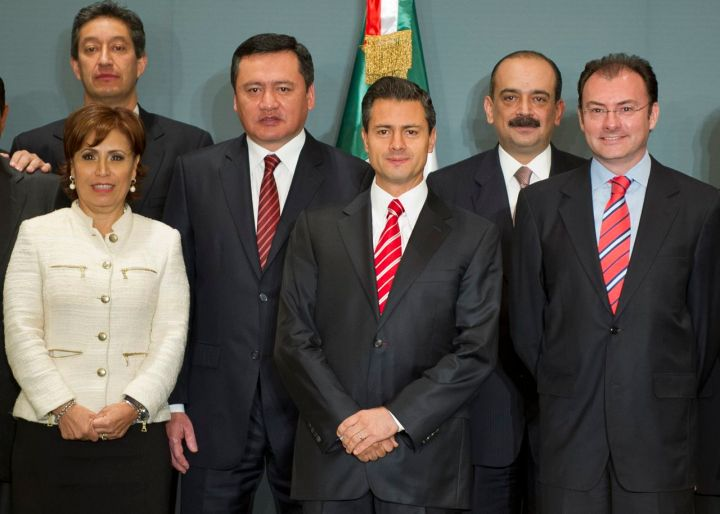 Mexico's President-elect Enrique Pena Nieto (C) poses with his transition team -- with members of the current government and the future one, towards his inauguration on December 1 -- after presenting it in a press conference in Mexico City on September 4, 2012. Pictured here, Erwin Lino Zarate (L, back), Mexico City's former mayor Rosario Robles (L), fomer governor of the state of Hidalgo and current collaborator of Pena Nieto, Miguel Angel Osorio Chong, (3-L), Sebastian Lerdo de Tejada (2-R) and Luis Videgary Caso.  AFP PHOTO/Alfredo ESTRELLA        (Photo credit should read ALFREDO ESTRELLA/AFP/GettyImages)